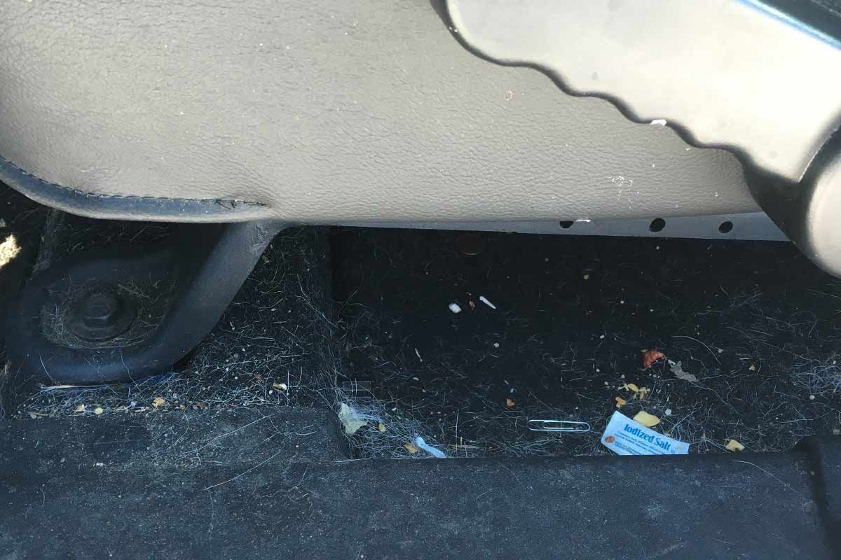 dirty under car seat before detail