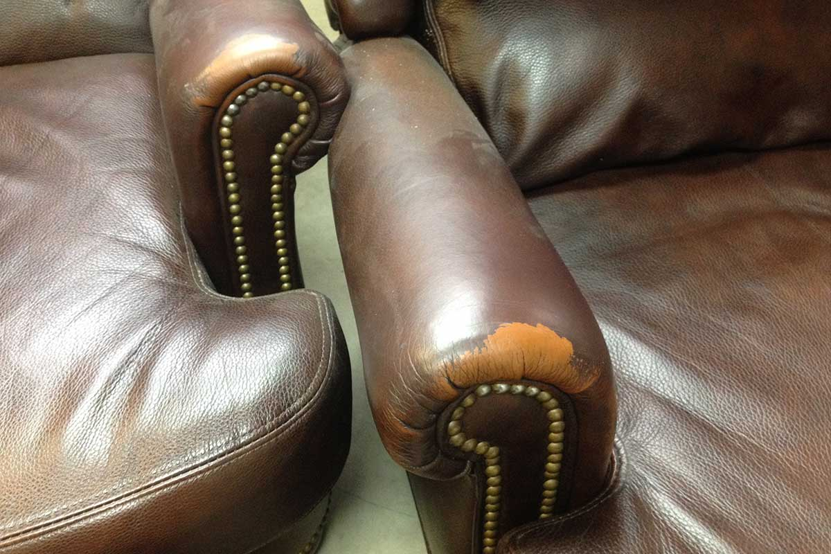 miscolored and stained leather chairs