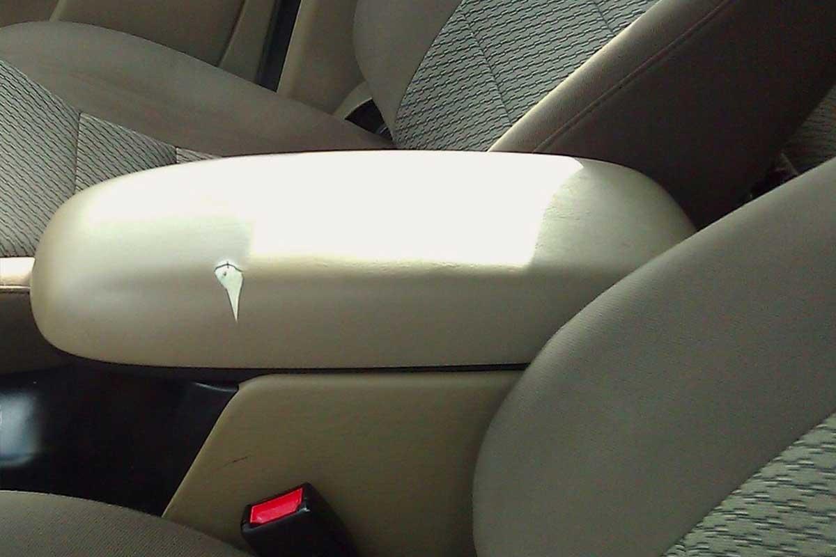 vinyl car armrest tear