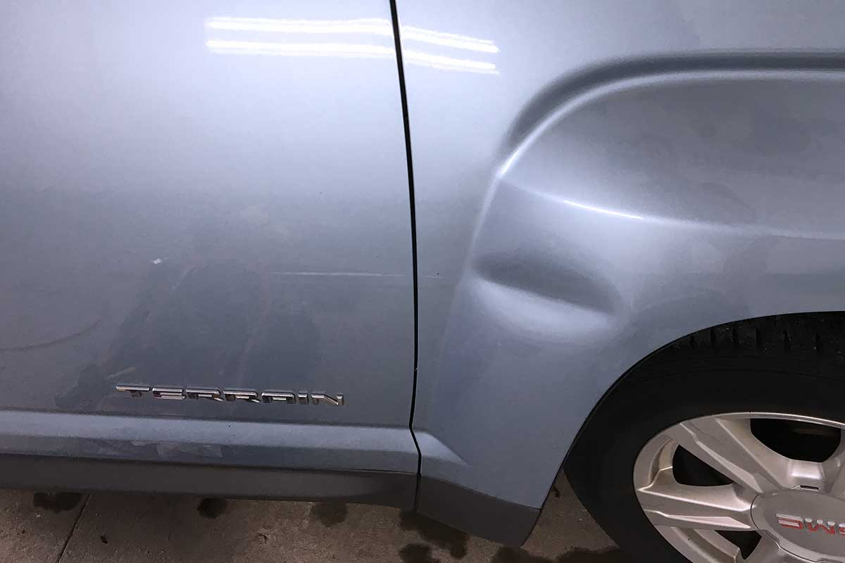 gray terrain paintless dent repair before