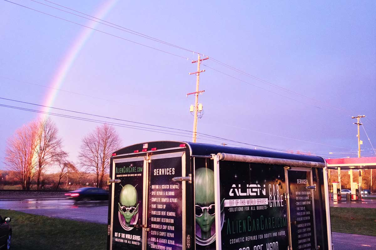 Alien Car Care trailer under Rainbow